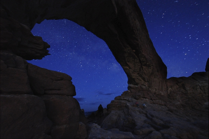 Starry night sky and rock formation, Arches National Park, Utah